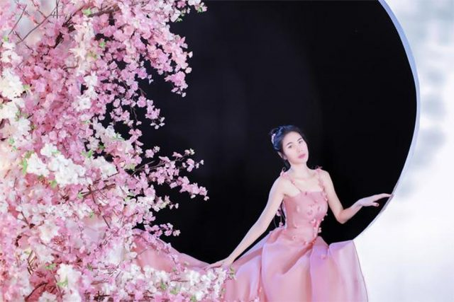 thuy tien in pink dress and flowers